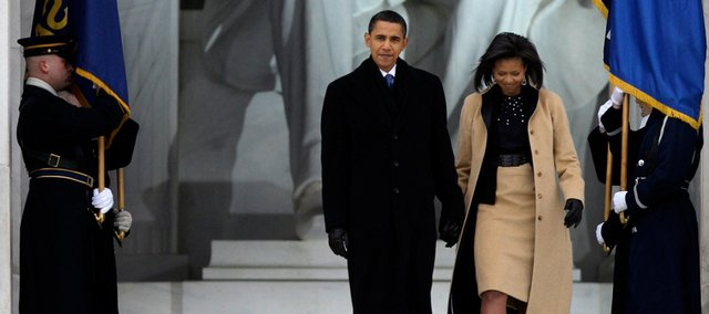 "President-elect Barack Obam and his wife Michelle Obama, arrive at ""We Are One: Opening Inaugural Celebration at the Lincoln Memorial"" Sunday, Jan. 18, 2009, in Washington."
