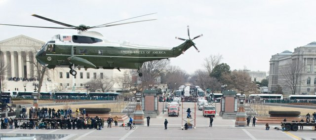 President Barack Obama waves alongside his wife, Michelle, and US Vice President Joe Biden and his wife, Jill, as former President George W. Bush and his wife, Laura, leave the US Capitol by helicopter after Obama was sworn in as the 44th President in Washington, Tuesday, Jan. 20, 2009.