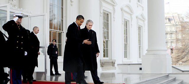 President Bush, right, walks out with President-elect Barack Obama, left, on the North Portico of the White House before sharing the Presidential limousine enroute to Capitol Hill for inauguration in Washington, Tuesday.