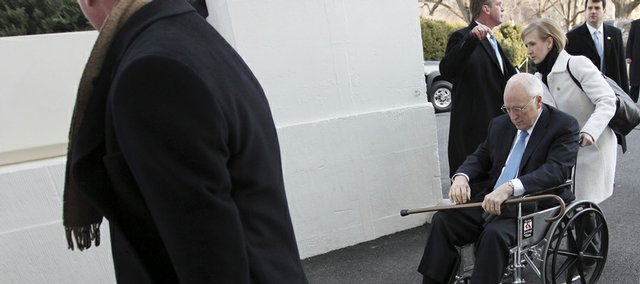 Vice-President Dick Cheney is assisted to his vehicle in a wheelchair on the North Portico of the White House as he heads to Capitol Hill for the inauguration of President-elect Barack Obama in Washington, Tuesday.