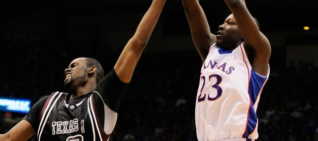 Kansas forward Mario Little puts up a shot over Texas A&M forward Bryan Davis during the first half Monday, Jan. 19, 2009 at Allen Fieldhouse.