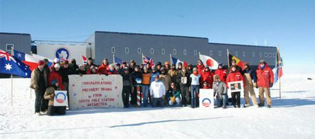 Fire fighter Justin Maughmer and co-workers for Raytheon Polar Services in Antarctica celebrate at the South Pole.