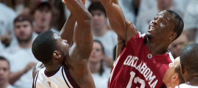 Texas A&M's Donald Sloan (15) goes up for a shot as Oklahoma's Willie Warren (13) defends during the second half of an NCAA college basketball game Saturday, Jan. 17, 2009 in College Station, Texas. Oklahoma won 69-63.
