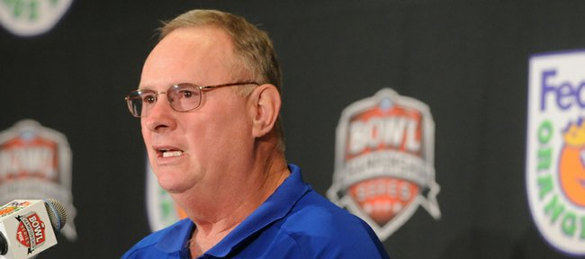 Kansas defensive coordinator Bill Young speaks with media members during a press conference in this Dec. 30, 2007, file photo. Young was hired as the Oklahoma State Cowboys' defensive coordinator on Tuesday.