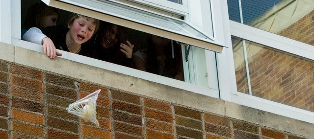 Students in the enrichment class at Pinckney Elementary dropped eggs from a second story window Thursday. Thomas Becker watches his egg structure fall after he released it. It did not survive.
