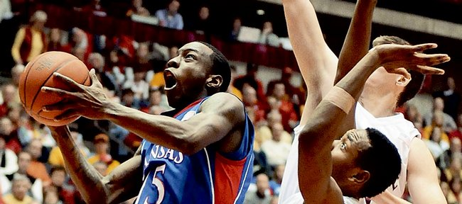 Kansas guard Tyshawn Taylor soars in to the bucket against Iowa State defenders Craig Brackins, front, and Jamie Vanderbeken during the second half, Saturday, Jan. 24, 2009 at Hilton Coliseum in Ames, Iowa.