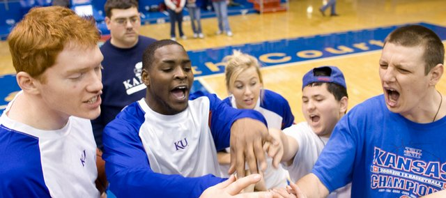 Kansas University's Matt Kleinmann and Sherron Collins join Chad Schuster, Parsons, far right, and the rest of the group at their station in a cheer during the 25th annual Wilt Chamberlain Basketball Clinic Sunday, Jan. 24 2009, at Allen Fieldhouse.