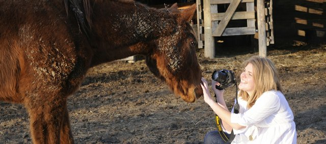 Sarah Stern works to take some photographs of her horse Amanda.