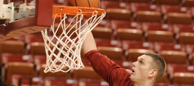 Kansas center Cole Aldrich throws down a dunk during warmups before tipoff against Nebraska Wednesday, Jan. 28, 2009 at the Devaney Center in Lincoln.