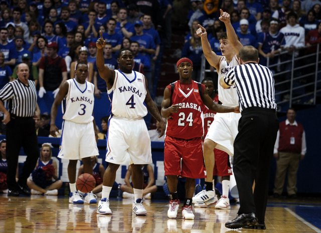 Kansas defenders Sherron Collins and Sasha Kaun lobby for a call from a game official along with Nebraska guard Cookie Miller during the first half Saturday, Jan. 26, 2008 at Allen Fieldhouse.