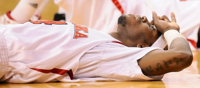 Frustrated Nebraska guard Cookie Miller takes his time getting up after being whistled for a blocking foul on Kansas guard Tyshawn Taylor late in the second half Wednesday, Jan. 28, 2009 at the Devaney Center in Lincoln.