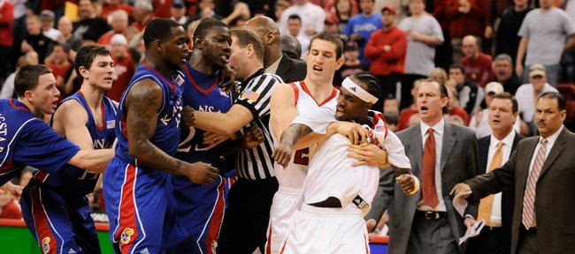 Kansas' Mario Little (23) and Nebraska guard Cookie Miller are restrained during a scuffle in the second half Wednesday, Jan. 28, 2009 at the Devaney Center in Lincoln. Both benches cleared to restrain the players.