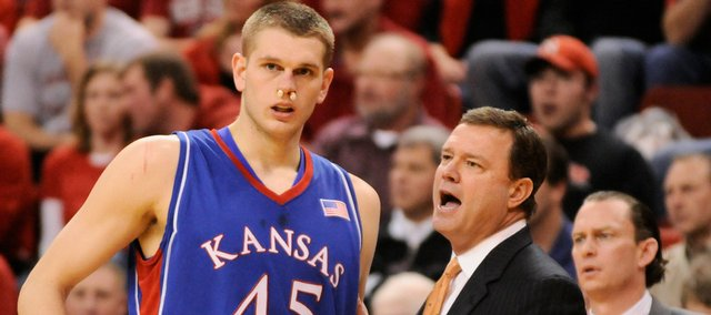 KU center Cole Aldrich, who has his nose stuffed to stop a bit of bleeding, talks with Kansas head coach Bill Self during the second half Wednesday, Jan. 28, 2009 at the Devaney Center in Lincoln.