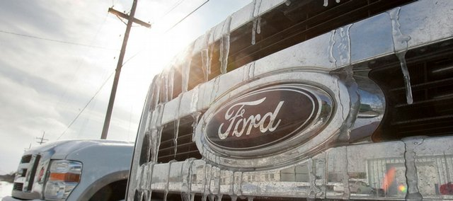 Icicles form on the grille of a Ford vehicle on a dealer's lot Tuesday in Omaha, Neb. Ford reported a $5.9 billion fourth-quarter loss Thursday, but says it still has no plans to seek federal aid.