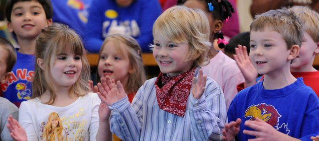 "Celebrating Kansas Day with a rendition of ""I'm a Jayhawk"" are Quail Run School kindergartners, from left, Ashton Weeks, Braxton McCullough and Ryley Wheat. The students' program took place Thursday in the library for their parents."