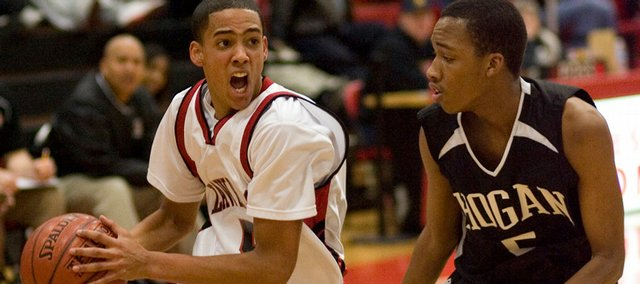 Lawrence High's Marcus Ray (5) looks to drive the lane against Hogan Prep's Maurice Mason (5) during the game Thursday, Jan. 29, 2009, at LHS.