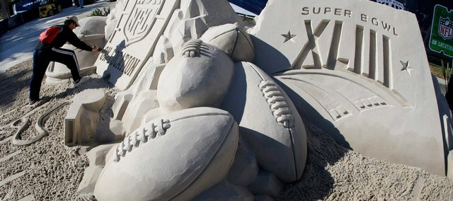 Stephen Schomaker works on a Super Bowl XLIII sand sculpture outside the stadium in Tampa, Fla., on  Saturday. The sculpture took almost three days to create using 50 tons of sand.