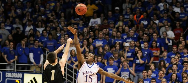 Kansas guard Tyshawn Taylor tips a shot by Colorado guard Nate Tomlinson during the first half, Saturday, Jan. 31, 2009 at Allen Fieldhouse. The tip forced a shot clock violation by the Buffs.