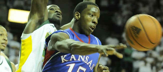 Kansas guard Tyshawn Taylor passes out to the wing as he is guarded by Baylor forward Quincy Acy during the first half Monday, Feb. 2, 2009 at the Ferrell Center in Waco.