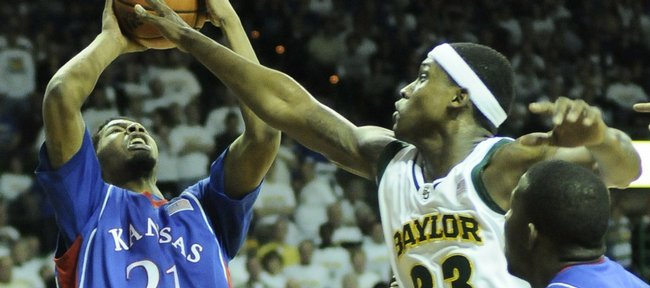 Kansas forward Markieff Morris pulls an offensive rebound away from Baylor forward Kevin Rogers during the second half Monday, Feb. 2, 2009 at the Ferrell Center in Waco.