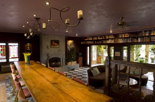 Jack Collins' home is a study in contrasts. Entertaining is also a big part of Collins' life, so a large dining table was a requirement.