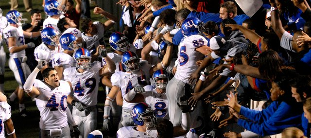 The Kansas University football team flocks to its fans after a 43-28 victory against Oklahoma State. The Jayhawks beat the Cowboys Nov. 10 at Boone Pickens Stadium in Stillwater. The KU football team's dramatic success in 2007 has been named the top local story of 2007 by the Journal-World and 6News staff.