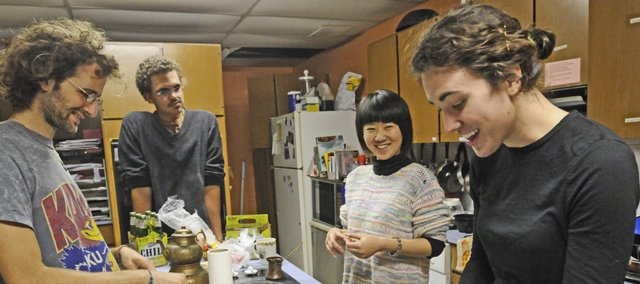From left, Jonathan Wiens Blum, Danny Spence, Chelsea Zhou and Jenn Hunt collaborate on dinner in the basement of the Ecumentical Christian Ministries building, 1204 Oread Ave., in this October 2008 photo. Six residents and a cat live in the basement of the ECM in a co-op living community called Koinonia.