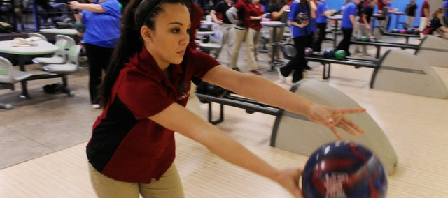 Lawrence junior Alexah Gudenkauf works on her routine before competition. The Lions boys finished second, while the girls placed third at their home meet at Royal Crest Lanes.