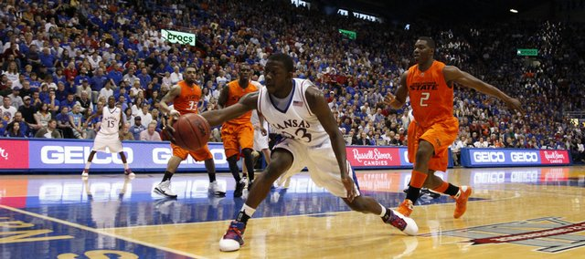 Kansas forward Mario Little saves a ball headed out of bounds during the second half Saturday, Feb. 7, 2009 at Allen Fieldhouse.