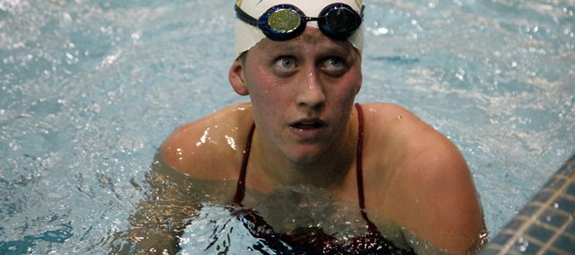 Kansas University's Shannon Garlie looks to the clock to see that she won the 800-yard freestyle Friday at Robinson Natatorium.