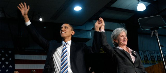 In this Jan. 29, 2008, file photo, then-Sen. Barack Obama, and Kansas Gov. Kathleen Sebelius accept applause at the Butler Community College Gymnasium in El Dorado. Sebelius is President Barack Obama's pick to head the Health and Human Services Department, a White House source said Saturday.