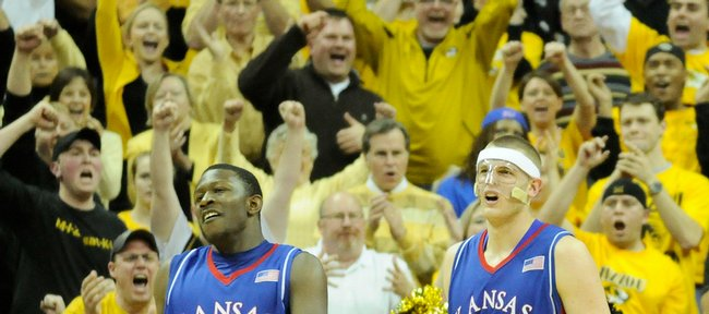 Kansas defenders Mario Little, left, and Cole Aldrich take a bit of harassment from the Missouri faithful during the second half Monday, Feb. 9, 2009 at Mizzou Arena.