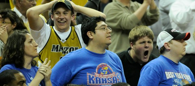 A handful of Kansas fans get an earful from Missouri fans as the Tigers come back from their deficit.