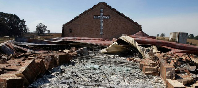 The remains of St. Andrew's church are scattered Monday after it was destroyed by fire in the community of Kinglake, northeast of Melbourne, Australia.