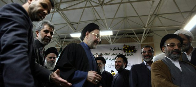 Escorted by his bodyguard and allies, Iran's former reformist President Mohammad Khatami, center, attends a ceremony organized by his party, a group of pro-reform clerics, Sunday in Tehran, Iran. Iran's former reformist president declared Sunday that he would run for president again in the country's upcoming elections, posing a serious challenge to hard-line President Mahmoud Ahmadinejad.