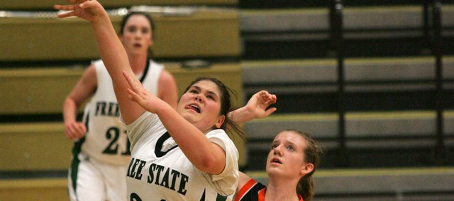 Free State junior Katie Scrivo positions herself for an offensive rebound during the second half. Scrivo had 10 points, eight rebounds, three blocks and one steal in the Firebirds' 37-32 victory against Shawnee Mission Northwest on Tuesday at Free State High.
