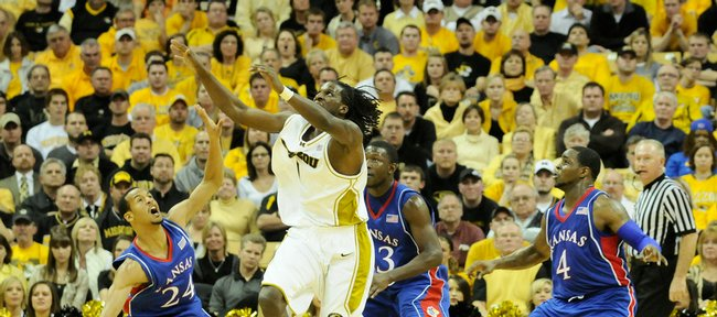 Missouri forward DeMarre Carroll, center, battles for a loose ball against Kansas defenders Travis Releford, left, Mario Little, back, and Sherron Collins on Feb. 9 at Mizzou Arena.