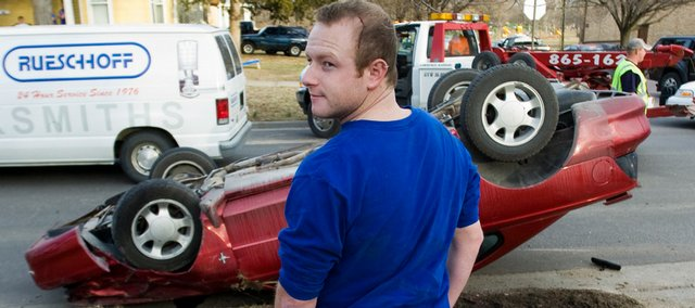 Justin Goff, a Kansas University senior, suffered only a scrape on the head as after his Ford Mustang rolled over on Kentucky Street. A van hit his car on Tuesday afternoon and caused it to flip.