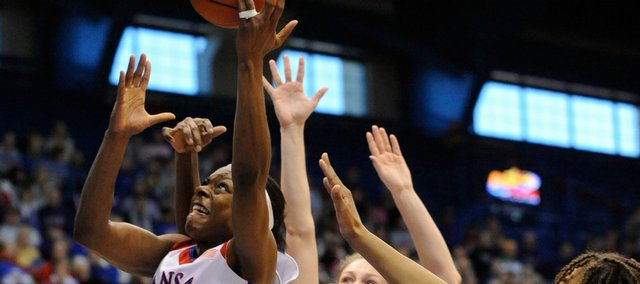KU's Danielle McCray drives against K-State Saturday, January 24, 2009 at Allen Fieldhouse.