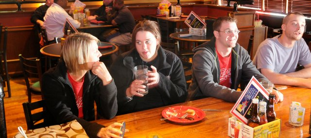 Having lunch at Bigg's BBQ, 2429 Iowa, on Thursday are, from left, Kansas University students Kelly Dixon, of Wichita, Katie Mowrey, of Lawrence, Joel Hanzlick, of Hill City, and KU graduate Mason Graham. Bigg's is one of 17 locally owned restaurants, plus Checkers grocery store, that have created the Lawrence GiveBack Card program, which benefits charities as well as the cardholder.