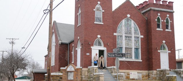 Church members exit the St. Luke African Methodist Episcopal Church, 900 N.Y., after Sunday services recently. The historic East Lawrence church is in need of maintenance to save the century-old building.