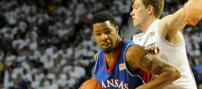KU's Marcus Morris drives on K-State's Darren Kent in the second half on Saturday, Feb. 14, 2009 at Bramlage Coliseum in Manhattan.