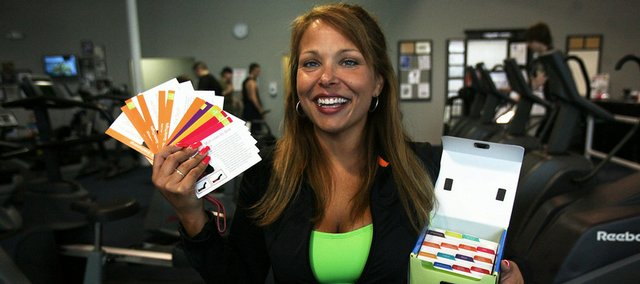 "Lori Wengle, 38, displays her product at Howell Fitness Center in Howell, Mich, Wengle is a personal trainer that has developed a product she calls ""A Personal Trainer in a Box"" after losing 107 pounds six years ago."
