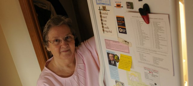 Joan McGriff, Lawrence, uses her refrigerator for not only a food storage unit but to track how much food one would need to live for a year. She also posts spiritual passages on the refrigerator.