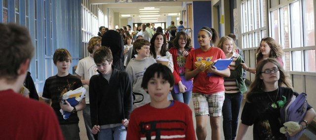West Junior High School students travel the hallway between classes in Feb. 2009.
