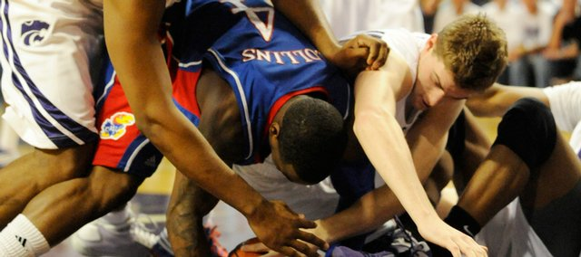 KU's Sherron Collins fights for a loose ball with several Wildcats on Saturday, Feb. 14, 2009 at Bramlage Coliseum in Manhattan.