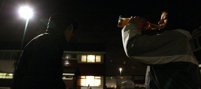 "Teenagers drink alcohol on a street corner last week on a rundown estate in Hebburn, England. In the latest symbol of what some are calling ""broken Britain,"" 13-year-old Alfie and his 15-year-old girlfriend, Chantelle, became parents last week. The problem of binge drinking among young people in Britain shows up in a rise in liver disease among Britons in their 20s."