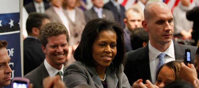 first Lady Michelle Obama, followed by Housing and Urban Development Secretary Shaun Donovan, left, greets a crowd after making remarks at the HUD offices in Washington in this Feb. 4 file photo.
