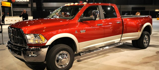 The 2010 Dodge Ram Heavy-Duty truck is shown at the Chicago Auto Show last week in Chicago. Treasury Secretary Timothy Geithner and National Economic Council Director Lawrence Summers are expected to oversee a governmental panel supervising the restructuring of the auto industry, a senior administration official said Sunday.