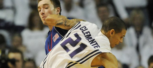 Kansas University guard Brady Morningstar takes an elbow from Kansas State's Denis Clemente (21) during a 2009 game in Manhattan.
